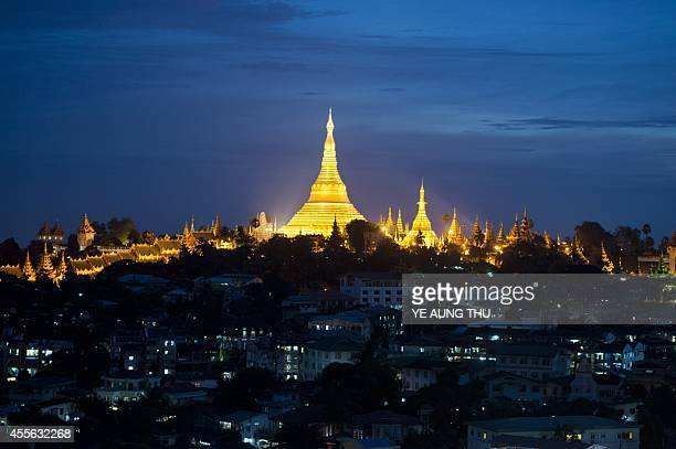 This picture taken on September 17 2014 shows the Shwedagon Pagoda at dusk in Yangon Myanmar's first census in three decades shows the country has a...