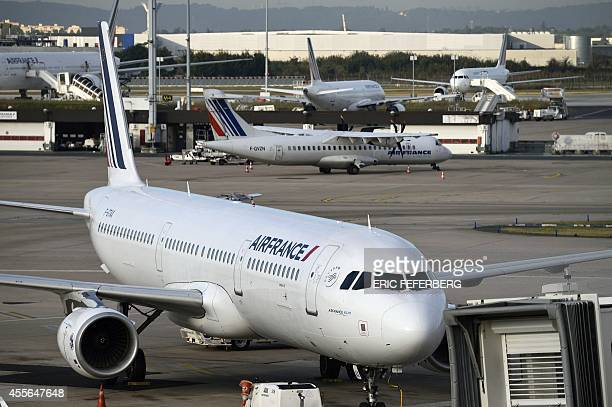 This picture taken on September 18 2014 shows Air France planes parked on the tarmac at Orly's airport near Paris French flag carrier Air France was...
