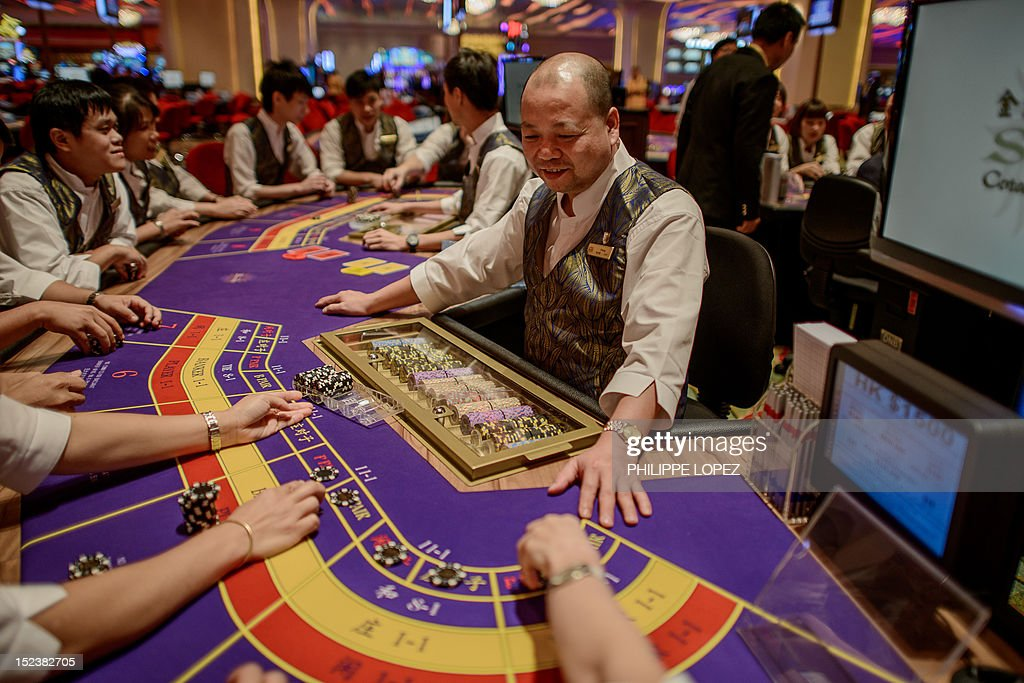 This picture taken on September 19 2012 shows a Sands casino employees during training in Macau Las Vegas casino boss Sheldon Adelson unveiled plans...