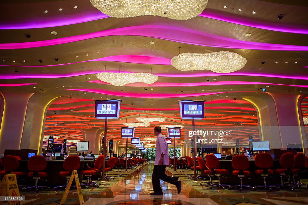 This picture taken on September 19 2012 shows a worker walking in the new Sands casino in Macau Las Vegas casino boss Sheldon Adelson unveiled plans...