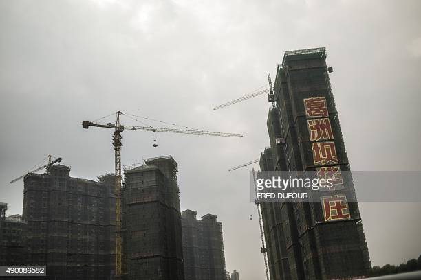 This picture taken on September 25 2015 shows a buildings under construction in Wuhan China's Hubei province AFP PHOTO / FRED DUFOUR