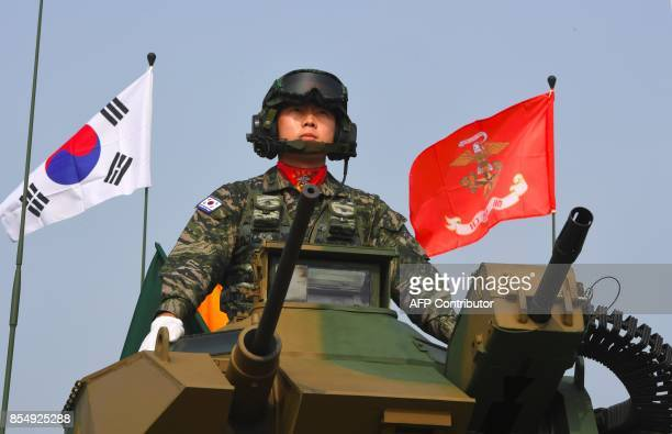 This picture taken on September 25 2017 shows a South Korean marine sitting on a Korea Amphibious Assault Vehicle during a media day presentation of...
