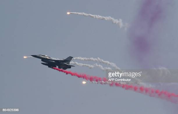 This picture taken on September 25 2017 shows a South Korean RF16 fighter jet firing flares during a media day presentation of a commemoration event...