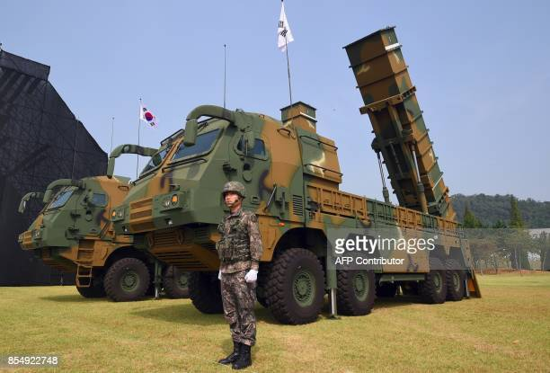 This picture taken on September 25 2017 shows a South Korean soldier standing by a Hyunmoo2 ballistic missile system during a media day presentation...
