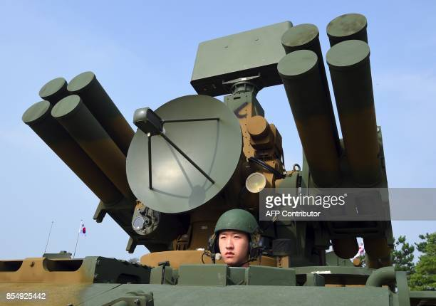 This picture taken on September 25 2017 shows a South Korean soldier sitting on a Chunma selfpropelled short range air defense missile system during...
