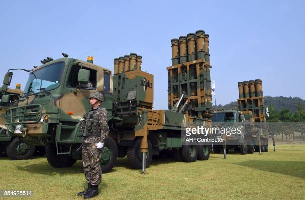 This picture taken on September 25 2017 shows a South Korean soldier standing by a Cheongung medium range surfacetoair missile system during a media...