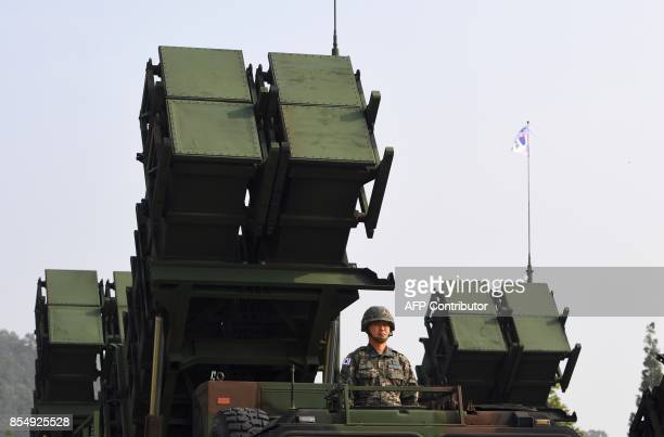This picture taken on September 25 2017 shows a South Korean soldier standing by a Patriot PAC2 missile system during a media day presentation of a...