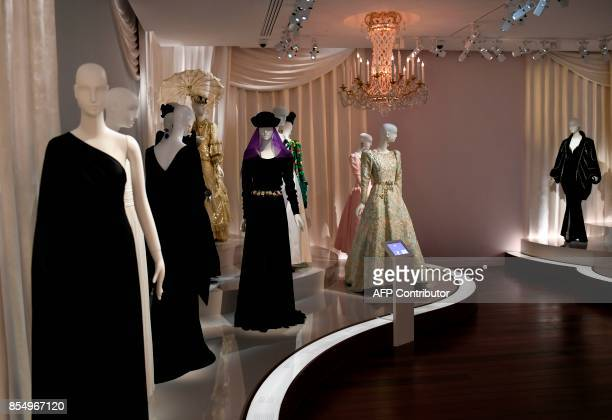 This picture taken on September 25 2017 shows examples of creations by the late French designer Yves Saint Laurent dispayed at the new Yves Saint...