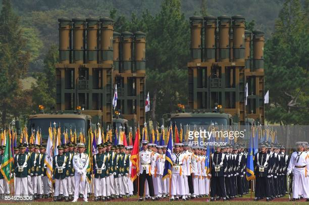 This picture taken on September 25 2017 shows South Korean honour guards standing in front of a Cheongung medium range surfacetoair missile system...