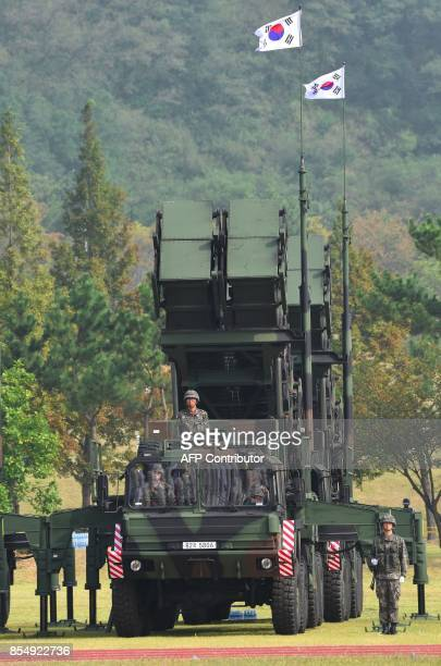 This picture taken on September 25 2017 shows South Korean soldiers standing by a Patriot PAC2 missile system during a media day presentation of a...