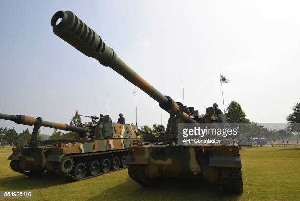 This picture taken on September 25 2017 shows South Korean soldiers sitting on a K9 155mm selfpropelled howitzer during a media day presentation of a...