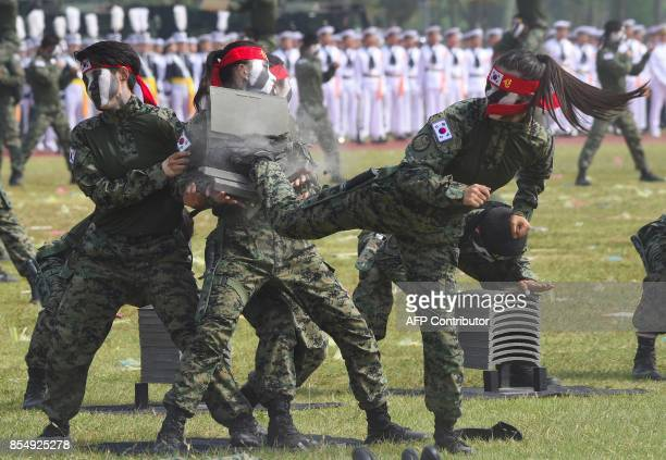 This picture taken on September 25 2017 shows South Korean Special Army soldiers performing martial arts during a media day presentation of a...