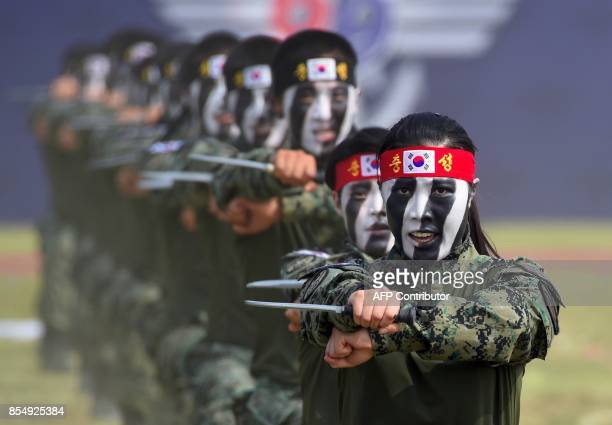 TOPSHOT This picture taken on September 25 2017 shows South Korean Special Army soldiers performing martial arts during a media day presentation of a...