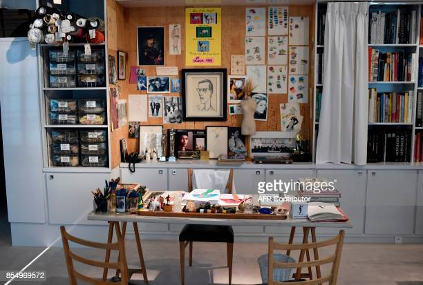 This picture taken on September 25 2017 shows the work benchcumdesk of late French designer Yves Saint Laurent dispayed at the new Yves Saint Laurent...