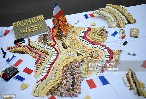 This picture taken on September 27 2015 shows a cheese platter creation depicting France during the first edition of the Cheese Fashion Week in Paris...