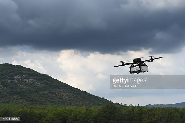 This picture taken on September 28 2015 shows a Geopost drone flying in Pourrieres southeastern France during a presentation of a prototype of a...