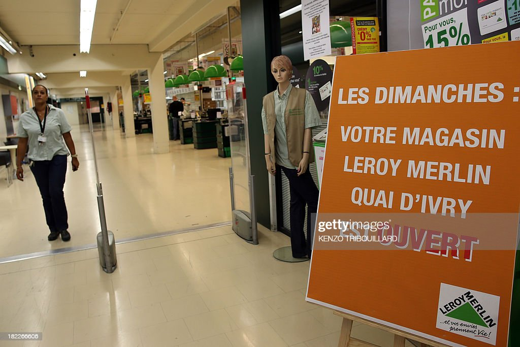 This picture taken on September 29, 2013 shows a placard reading 'On Sundays: your Leroy Merlin store is open' in a French hardware store 'Leroy Merlin' in Paris. The Bobigny tribunal outside Paris sentenced on September 26, 2013 Leroy Merlin and another hardware chain, Castorama, not to open 15 of their stores on Sundays, but the two brands decided not to comply with the decision.