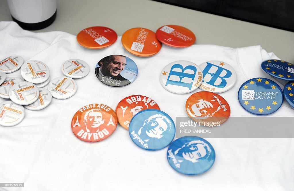 This picture taken on September 29, 2013 shows French centrist party Modem's badges during the party's meeting in Guidel, western France. French Modem president Francois Bayrou said on September 29 that French President Francois Hollande hadn't achieved his 'promises' and praised German chancellor Angela Markel's 'courage'.