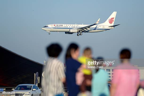 This picture taken on September 3 2014 shows an Air China Boeing 737 preparing to land at Beijing Capital International airport Boeing on September 3...