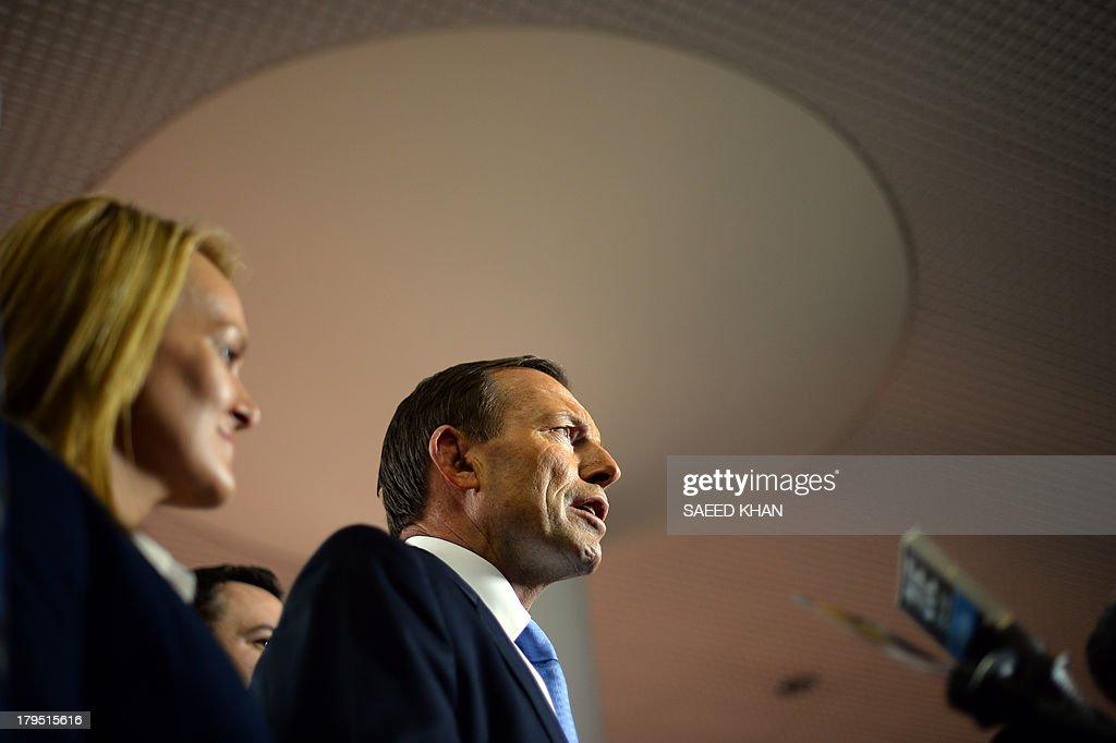 This picture taken on September 4, 2013 shows Australia's oppostion leader Tony Abbott talking to media during his election campaign in Penrith Sydney. The man tipped to become Australia's next prime minister has ditched his 'Mad Monk' tag and softened his macho image to turn around his conservative party's fortunes ahead of September 7, 2013 election. Tony Abbott, a former trainee Catholic priest, boxing enthusiast and monarchist, has in the past been known as a political hard man of the Liberal Party, unafraid of speaking his mind and occasionally tripping up on a gaffe. AFP PHOTO / Saeed KHAN
