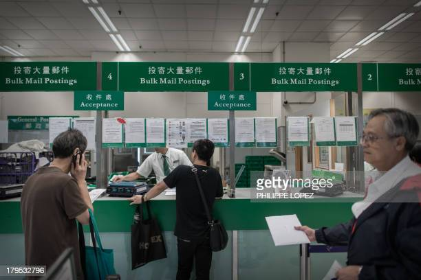 This picture taken on September 5 2013 shows customers queueing at the General Post Office in Hong Kong AFP PHOTO / Philippe Lopez