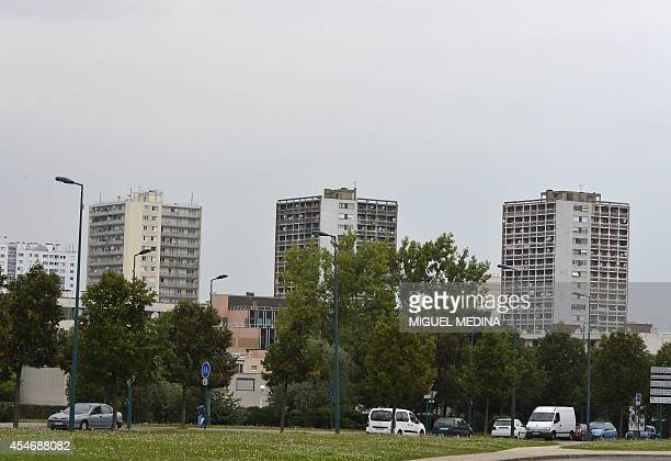 This picture taken on September 5 2014 shows residential buildings in the ValFourré neighborhood in ManteslaJolie 57 kms west of the French capital...