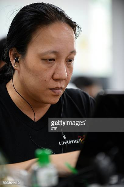 This picture taken on September 5 2016 shows an employee working inside the French IT company Linkbynet in Ho Chi Minh City A decade ago app...