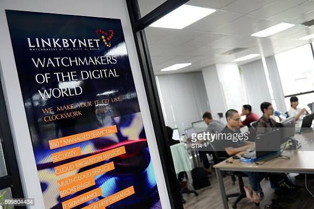 This picture taken on September 5 2016 shows employees working inside the French IT company Linkbynet in Ho Chi Minh City A decade ago app technology...