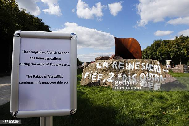 This picture taken on September 6 2015 in Versailles shows a sign before 'Dirty Corner' a 2011 CorTen steel earth and mixed media monumental artwork...