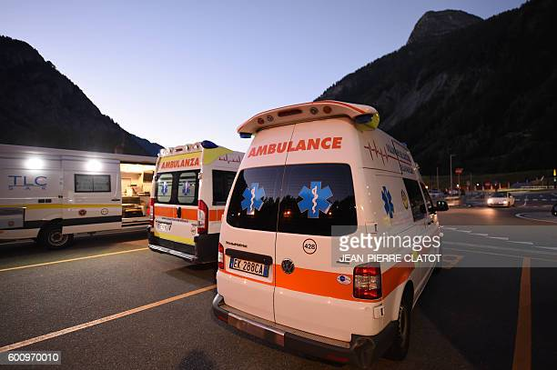 This picture taken on September 9 in Courmayeur shows Italian ambulances parked near the MontBlanc cable car 'Skyway' terminal during a rescue...