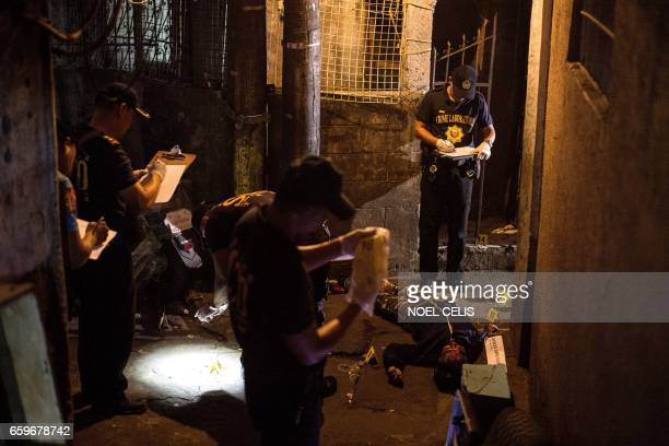 TOPSHOT This picture taken on the night of March 28 2017 shows an alleged drug dealer killed by an unidentified assailant in Manila Three turbulent...