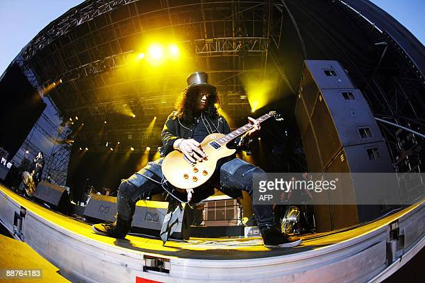 This picture taken with a fisheye effect shows US guitarist and former lead guitarist of US music band Guns N' Roses known as 'Slash' performing on...