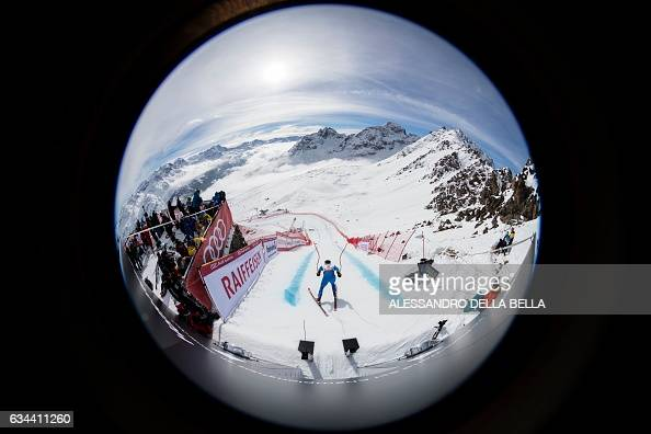 TOPSHOT This picture taken with a fisheye lens show Italy's Peter Fill at the free fall start as he takes part in a training session of the men's...