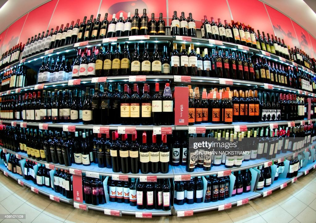 This picture taken with a fisheye lens shows shows red wine bottles displayed in one of the government controlled Systembolaget liquor stores in downtown Stockholm on December 19, 2013. Systembolaget is the only retail store allowed to sell alcoholic beverages that contain more than 3.5 percent (by volume) alcohol. According to Systembolaget, it has a nationwide retail network of 422 stores and over 500 agents serving smaller communities.