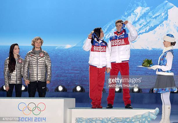 This picture taken with a robotic camera shows US gold medalists Meryl Davis and Charlie White and Russia's bronze medalists Elena Ilinykh and Nikita...