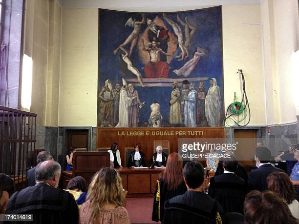 This picture taken with a smartphone shows Italian court reading the sentence on the last session of the trial of Italian former Prime Minister...