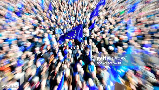 TOPSHOT This picture taken with a zoom effect shows people attending a proEurope demonstration on March 26 2017 in Berlin / AFP PHOTO / Tobias SCHWARZ