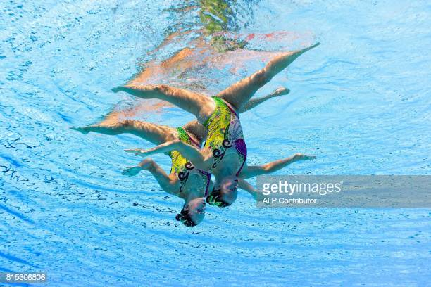 TOPSHOT This picture taken with an underwater camera shows Canada's Claudia Holzner and Canada's Jacqueline Simoneau competing in the Women Duet...