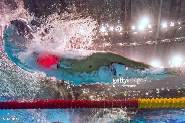 This picture taken with an underwater camera shows China's Sun Yang competing in the men's 400m freestyle heat during the swimming competition at the...