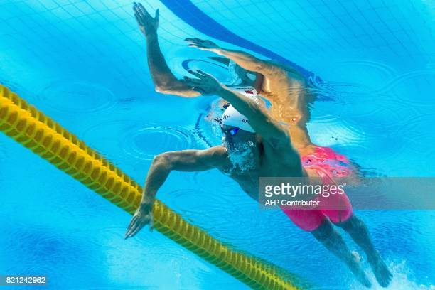 TOPSHOT This picture taken with an underwater camera shows China's Sun Yang competing in the men's 400m freestyle final during the swimming...