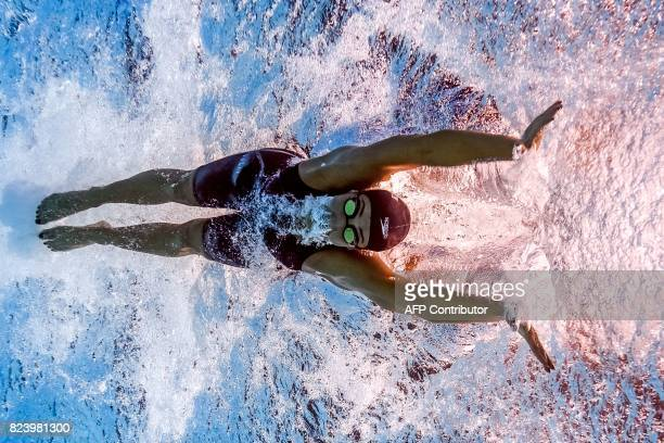 This picture taken with an underwater camera shows Egypt's Farida Osman competing in the women's 50m butterfly semifinal during the swimming...