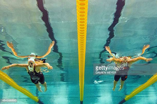 This picture taken with an underwater camera shows French swimmers Coralie Dobral and Fanny Deberghes competing in the women's 200m breaststroke...