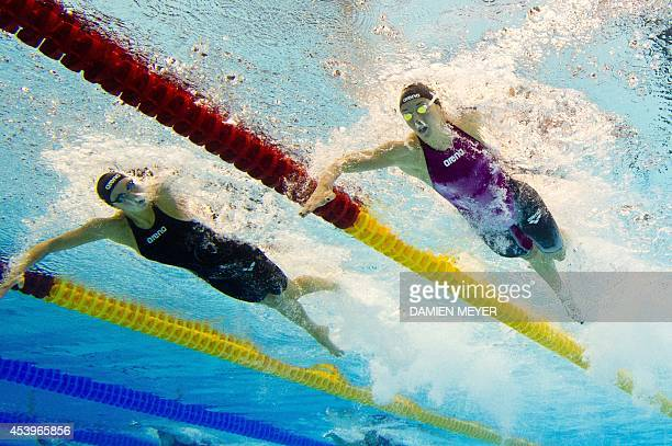 This picture taken with an underwater camera shows Hungary Katinka Hosszu and Russia Veronika Popova competing in the 200m freestyle women semifinal...