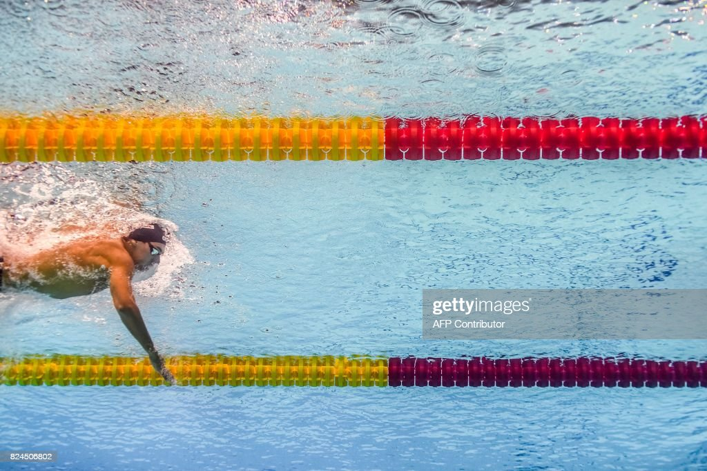 TOPSHOT - This picture taken with an underwater camera shows Italy's Gregorio Paltrinieri competing in the final of the men's 1500m freestyle during the swimming competition at the 2017 FINA World Championships in Budapest, on July 30, 2017. / AFP PHOTO / Martin BUREAU