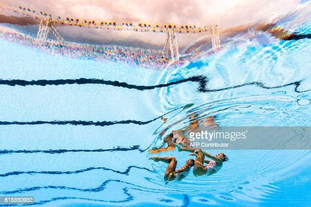 This picture taken with an underwater camera shows Italy's Linda Cerruti and Italy's Costanza Ferro competing in the Women Duet technical final...
