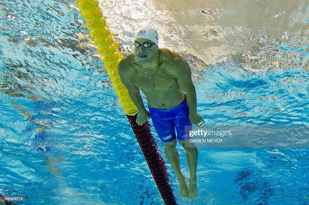 This picture taken with an underwater camera shows <a gi-track='captionPersonalityLinkClicked' href=/galleries/search?phrase=Michael+Weiss+-+Swimmer&family=editorial&specificpeople=14835132 ng-click='$event.stopPropagation()'>Michael Weiss</a> of the US competing in the Men's 400m individual medley preliminaries at the Pan American Games on July 16, 2015 in Toronto, Canada. AFP PHOTO / DAMIEN MEYER