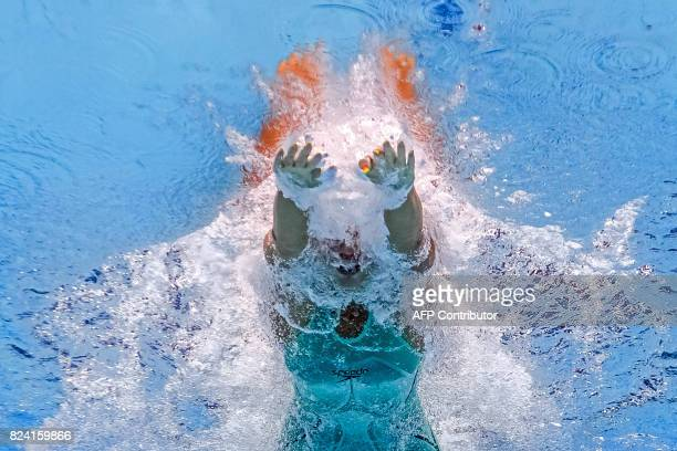 This picture taken with an underwater camera shows Russia's Yuliya Efimova competing in a heat of the women's 50m breaststroke during the swimming...