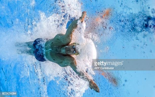 TOPSHOT This picture taken with an underwater camera shows South Africa's Cameron Van Der Burgh competes in the men's 50m breaststroke semifinal...