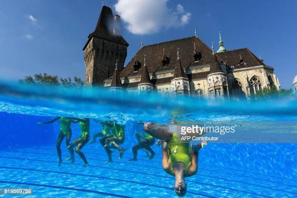 TOPSHOT This picture taken with an underwater camera shows swimmers practicing ahead of the Women's Free Combination Preliminary round during the...