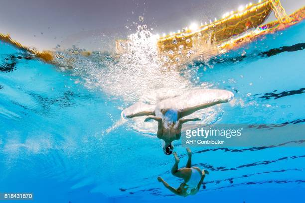 This picture taken with an underwater camera shows team China's Jiang Tingting and China's Jiang Wenwen competing in the women's duet free duo...